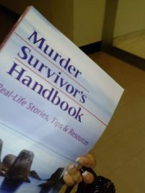 Murder Survivor's Handbook in the courthouse.